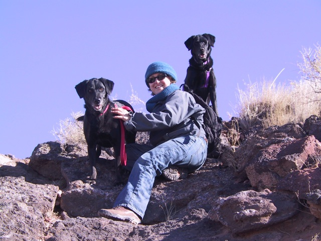 Jen and dogs climbing Black Volcano