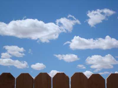 Clouds over my back fence.